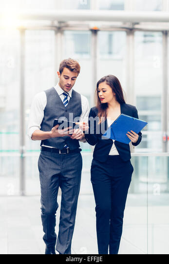 Business people meeting and sharing ideas - Stock Image