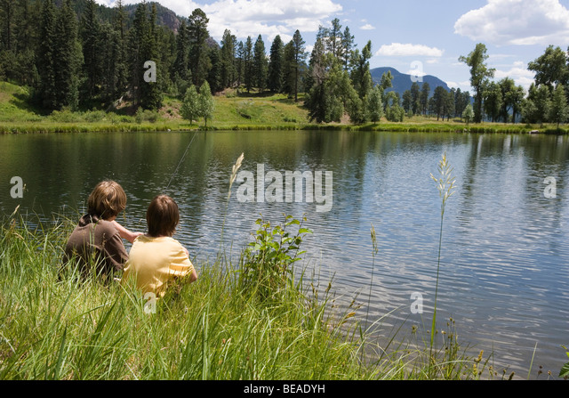 Two boys fishing at the edge of a lake, Durango, Colorado, USA - Stock-Bilder