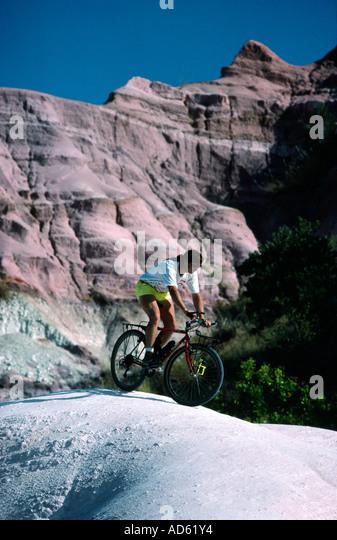 Andi Davis mountain biking in the Circe Rouge Madagascar - Stock Image