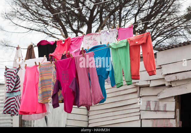 Clothes drying on a clothes line, Imizamo Yethu township, Cape Town, South Africa - Stock-Bilder