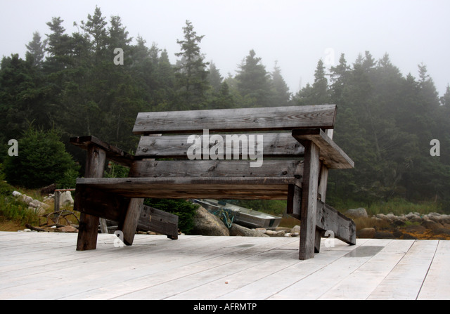 Adirondack bench on jetty. Photo by Willy Matheisl - Stock Image