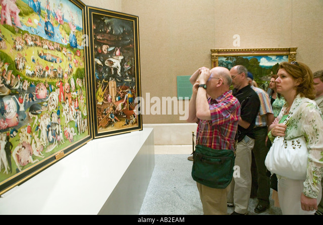Man photographs The Garden of Earthly Delights by Hieronymus Bosch in the Museum de Prado Prado Museum Madrid Spain - Stock Image