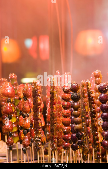 China, Heilongjiang, Harbin, Frozen Haw berries on a stick - popular Chinese winter snack - Stock-Bilder