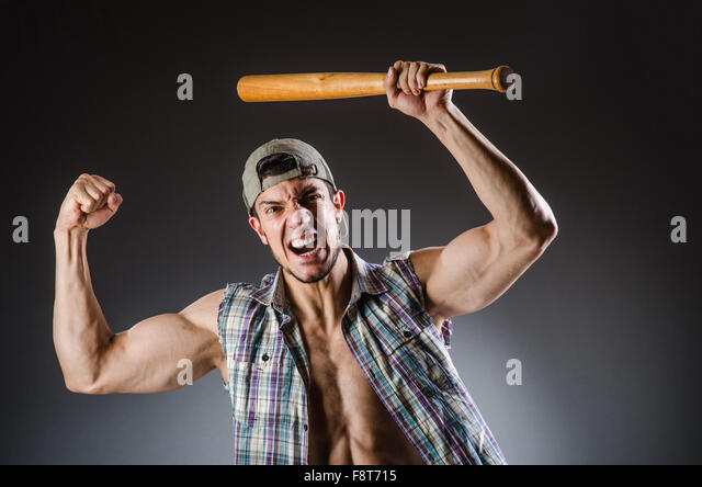 Violent man with baseball bat and hat - Stock Image