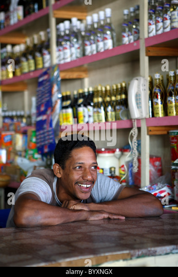 Caribbean, Dominican Republic, portrait of boy, grocery store - Stock Image