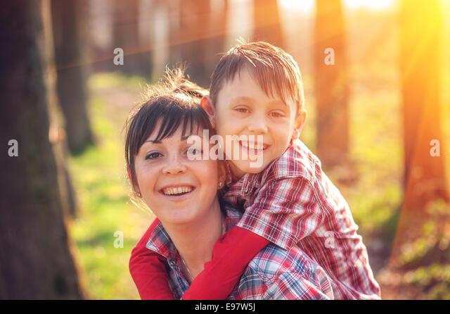 boy and mom have fun on park - Stock-Bilder