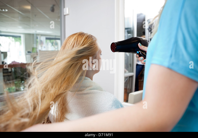 Blow drying Hair - Stock-Bilder