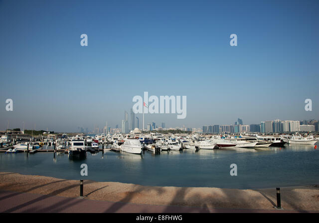United Arab Emirates, Abu Dhabi, Skyline with harbor in foreground - Stock Image