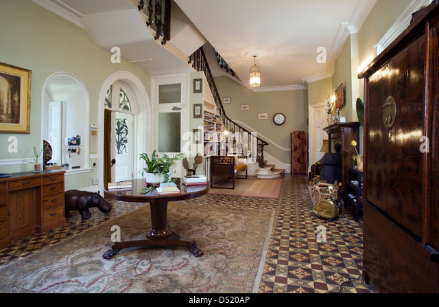 A large period entrance hall and stairs - Stock Image