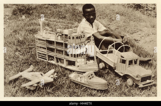 A boy in  Jesuit Mission in the Belgian Congo asks: 'What do you think of my work?' - he has made a fine - Stock-Bilder