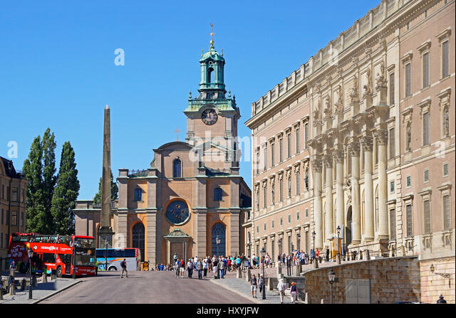Gamla Stan (Old Town) clock tower of Great Church (Storkyrkan) with The Royal Palace at right in Stockholm, Sweden. - Stock Image