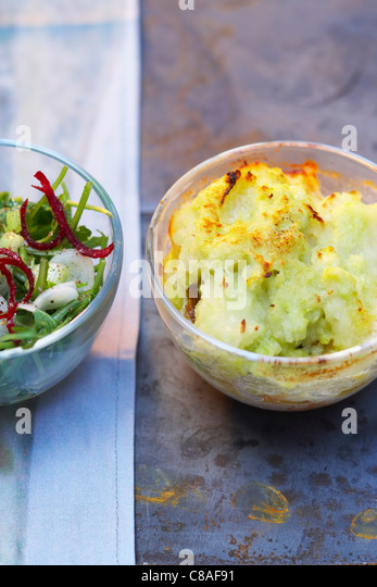 haddock,potato and leek pie and rocket and red onion salad - Stock Image
