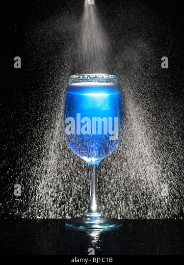 Blue glass with fresh icy water in motion - Stock Image