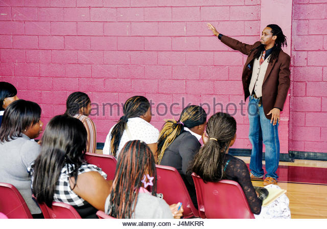 Miami Florida Overtown Overtown Youth Center Summer Career Training Program assembly student teen Black man girl - Stock Image