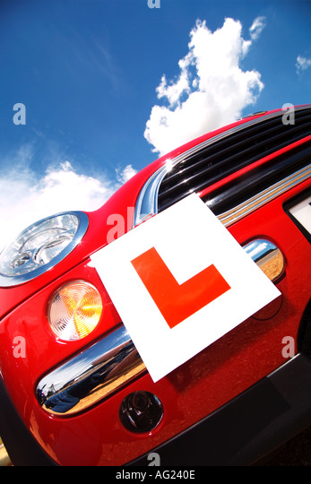 student Learner plates on a  red mini  big blue sky and sun - Stock-Bilder
