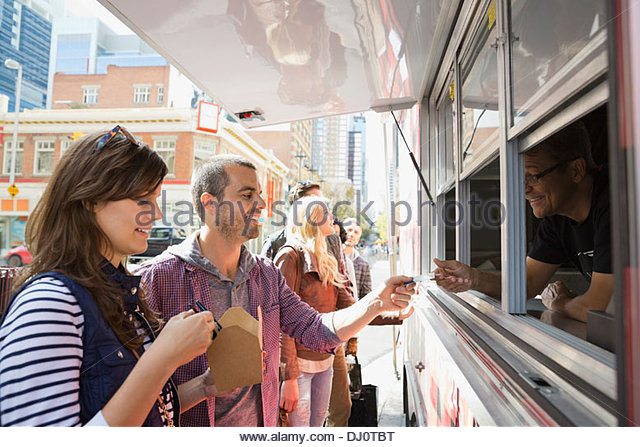 Couple paying for takeaway food - Stock Image