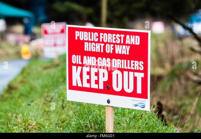 Sign erected by protesters warning oil and gas drilling companies to keep out of public land and protected water - Stock Image