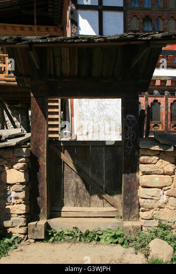 The gate of a private house in a village in the countryside between Jakar and Punakha in Bhutan. - Stock Image