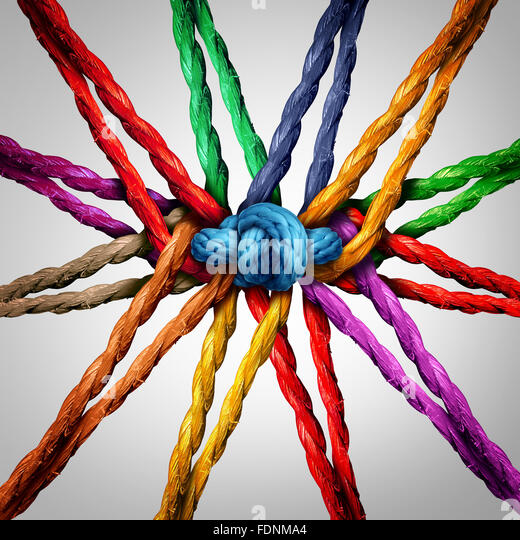 Group holding together as different ropes connected and tied and linked together in the center by a knot as a strong - Stock Image