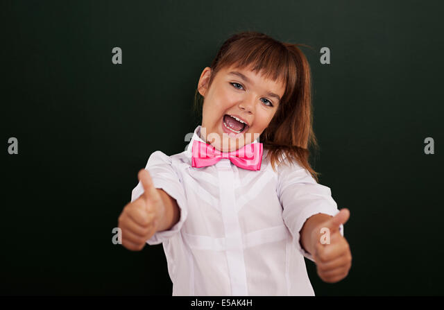 Happy girl showing thumb up, Debica, Poland - Stock Image