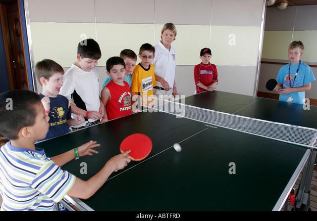 New York Atlantic Ocean Holland America Line ms Noordam Lido Deck ping pong table tennis boys - Stock Image