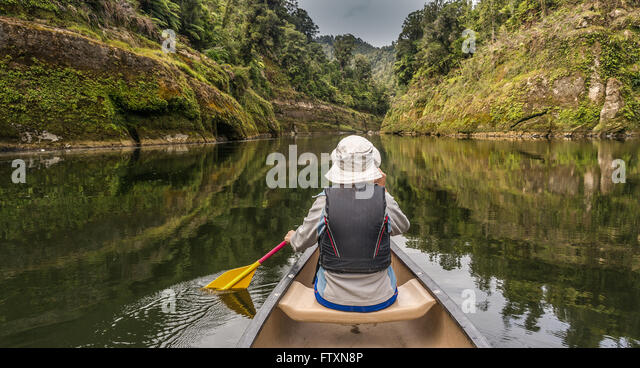 Woman canoeing on river Whanganui, North Island, New Zealand - Stock Image
