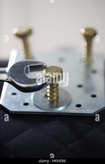 close up of wrench and bolt. maintenance, socket, work tool, spanner. - Stock-Bilder