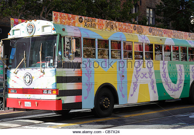 California San Francisco 7th Street sightseeing tour psychedelic custom painted 60s Magic Bus multi-media Haight - Stock Image