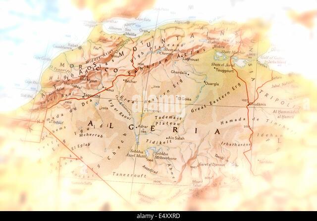 Traveler focused on Algeria - preparation for the journey - Stock Image