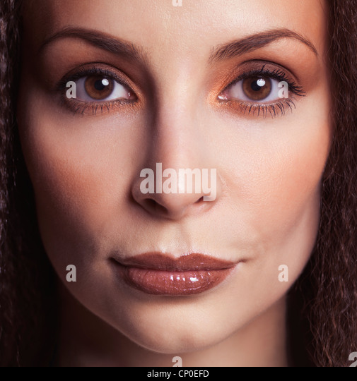 Closeup face beauty portrait of a woman with beautiful eyes in her early thirties - Stock Image