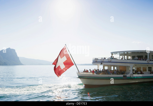 Passenger boat, liner, with the Swiss flag, Vitznau, Lake Lucerne, Canton of Lucerne, Switzerland, Europe - Stock Image