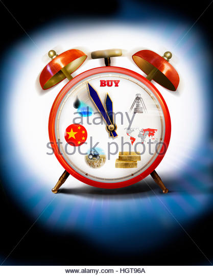 Alarm clock with commodities on clock face hands approaching midnight - Stock-Bilder