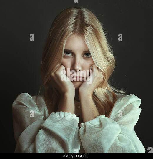 Beautiful girl with sulky expression . Dark portrait - Stock-Bilder