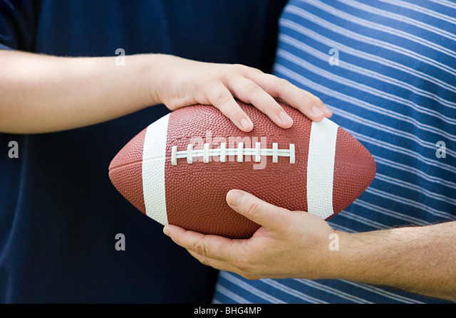 Father and son with american football - Stock Image