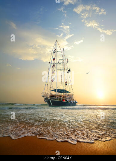 Sailing ship on the waves of Indian ocean - Stock Image
