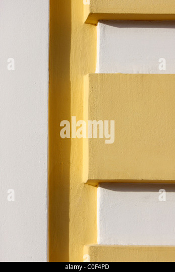 Yellow and white concrete texture with a shadow - Stock-Bilder