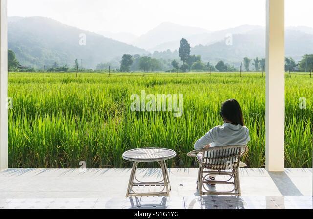 Women sit on the chair for relaxing. - Stock-Bilder