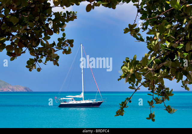 Sail boat moored at Megan's Bay. St. Thomas. US Virgin Islands - Stock Image