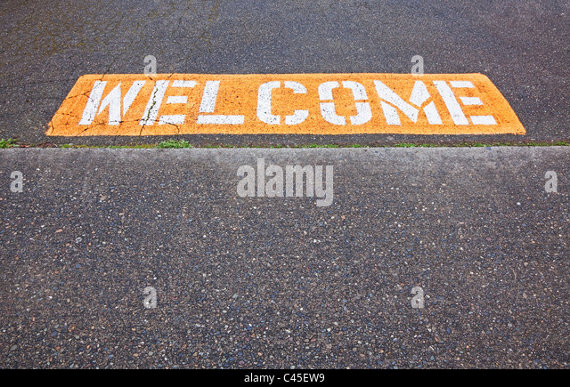 welcome sign at entrance to parking lot - Stock Image
