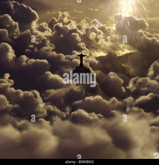 View at statue of Jesus Christ amidst cumulus clouds at sunset, Rio de Janeiro, Brazil, South America, America - Stock Image