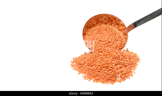 Dried red lentils with a soup ladle - Stock Image