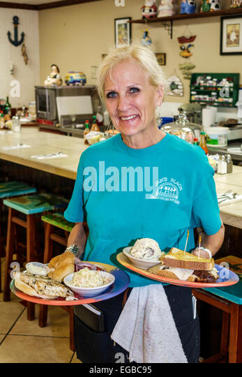 Florida Jensen Beach Jensen Beach Boulevard Jan's Place cafe restaurant senior woman working job employee serving - Stock Image