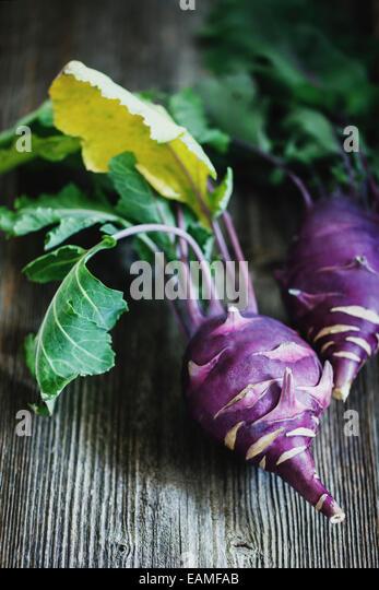 Kohlrabi cabbage on dark wooden background - Stock Image