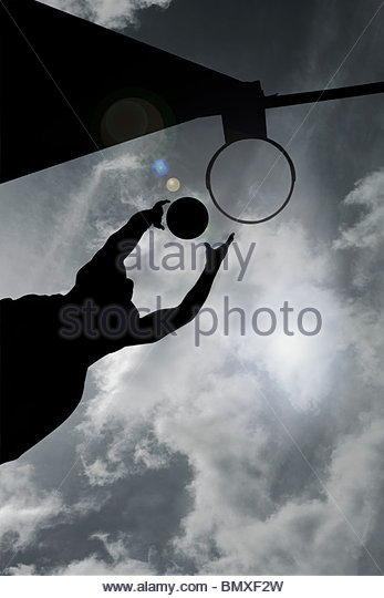Silhouette of basketball player - Stock Image
