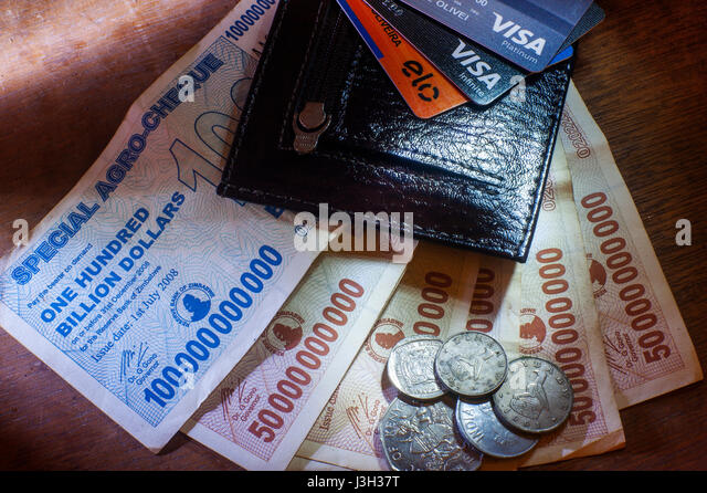 Wallet with notes of Zimbabwe billion dollars - Stock Image