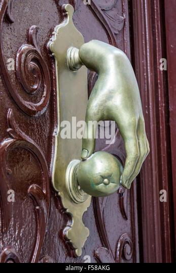 Spain Europe Spanish Toledo door handle hand grabbing apple - Stock Image