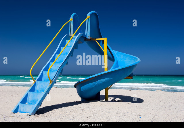Playground slide on the beach in Oman - Stock Image