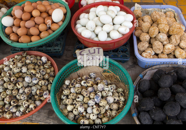 Assorted eggs for sale in market - Stock Image