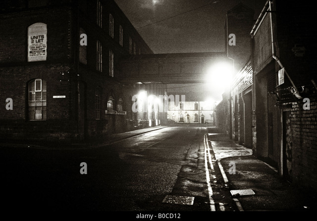 Moody night image of Victorian mills near Bury Lancashire UK - Stock Image