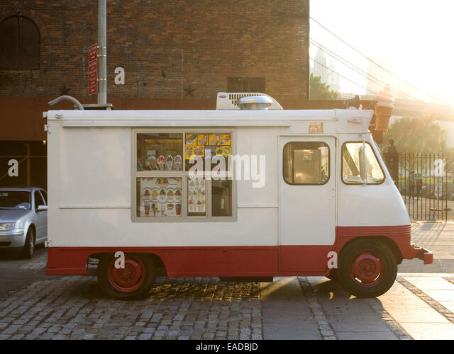 Ice Cream Truck at City Park on a Summer Afternoon - Stock Image